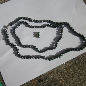 Dark green seed pearl necklace and earrings